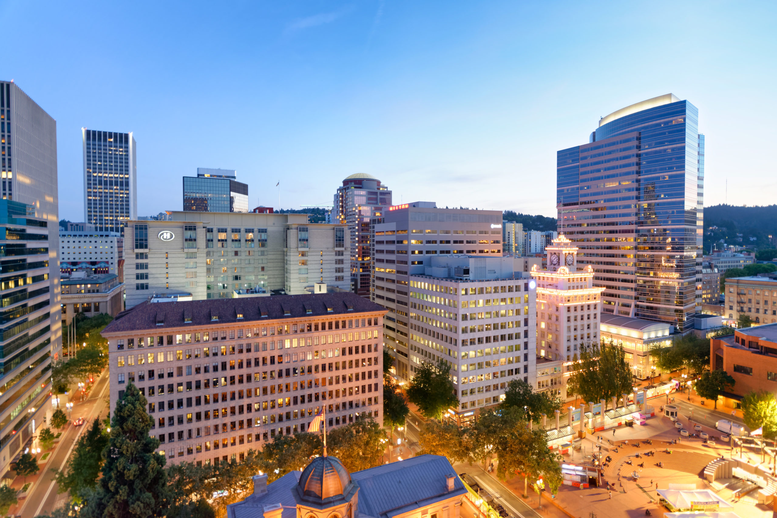 PORTLAND, OR – AUGUST 19, 2017: Aerial view of Pioneer Square at night. Portland attracts 5 million tourists annually.