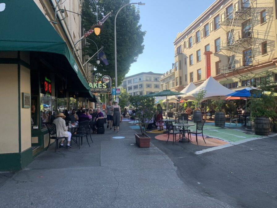 Downtown Portland street scene with outdoor diners